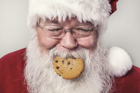 Santa enjoys the holiday season with plenty of cookies