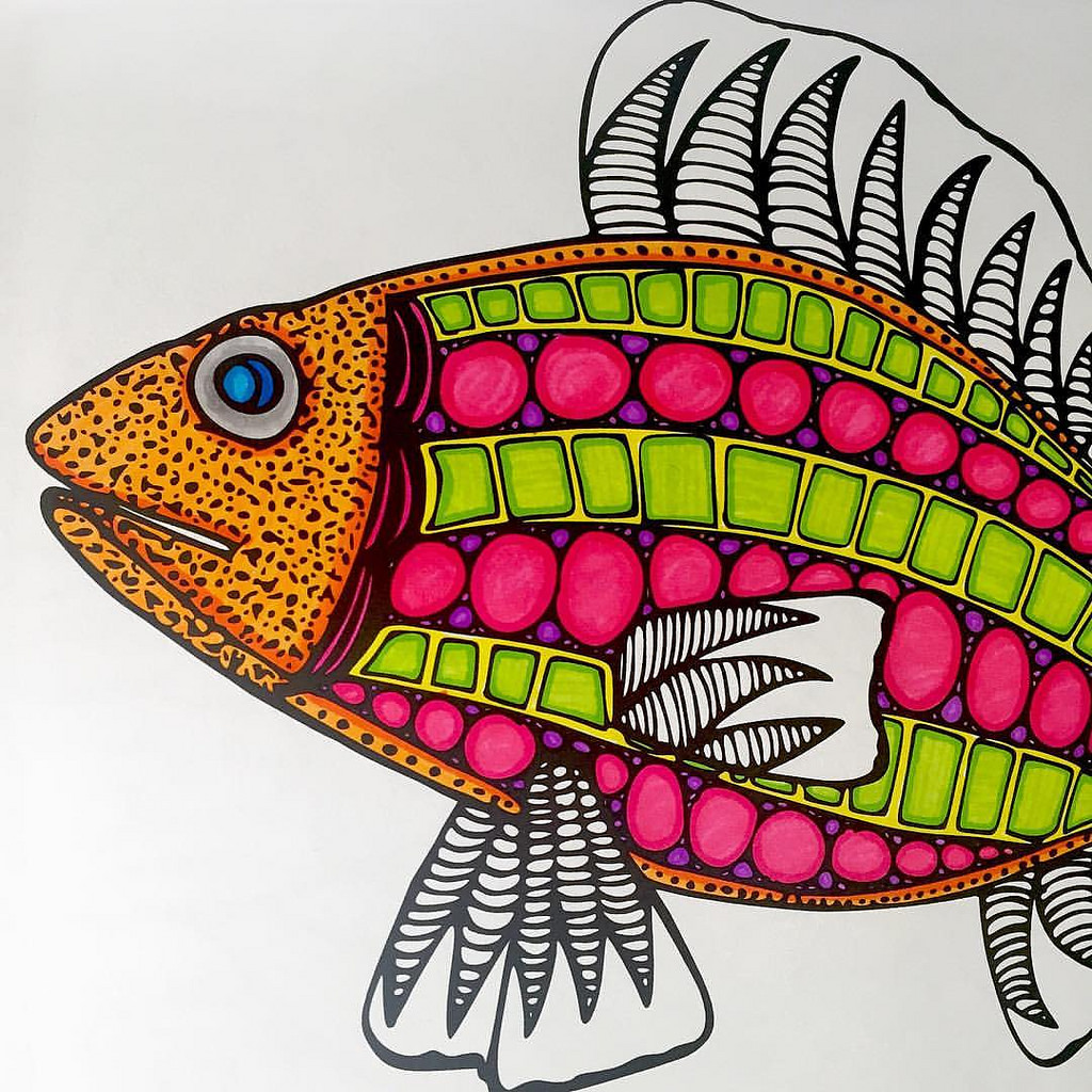 Coloring a fish design in coloring book is fun and relaxing.