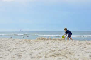 Building a great sandcastle takes patience and practice.