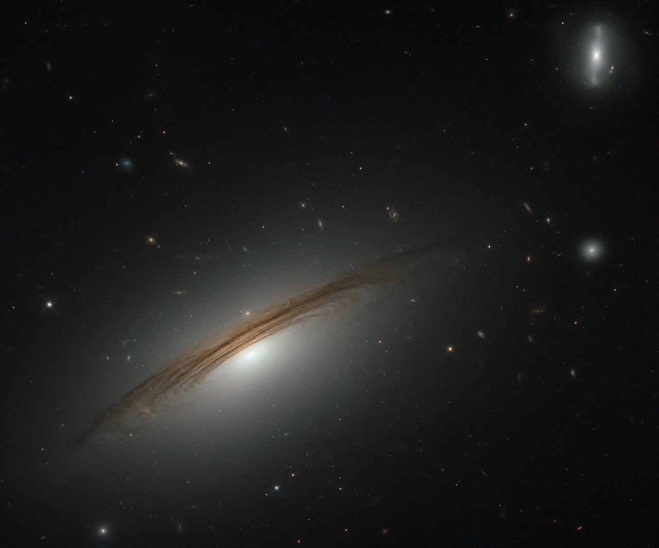 This NASA/ESA Hubble Space Telescope image showcases the remarkable galaxy UGC 12591. It is located just under 400million light-years away from Earth .