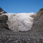 "The terminus, or ""toe"" of Exit Glacier, as seen in 2011 from the Outwash Plain below it. Exit Glacier will likely never look like this again as warmer temperatures over the past few years have reduced the mass of the glacier."