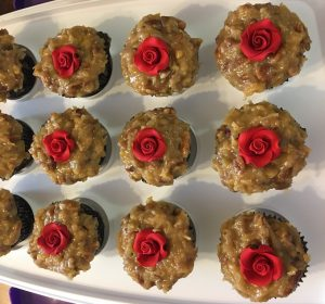We made a traditional Coconut-Pecan frosting for German Chocolate Cupcakes, and decorated with a single red rose.