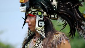 Watch pow wow singing, dancing and drumming as Native American people celebrate their history and traditions.