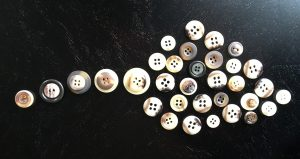 Creating art with buttons is a fun arts and crafts project.