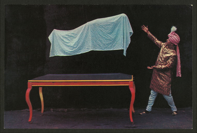 An assistant floats in the air as the magician defies gravity.